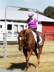 Adrianne Fenton rides during a lesson at HATS, which