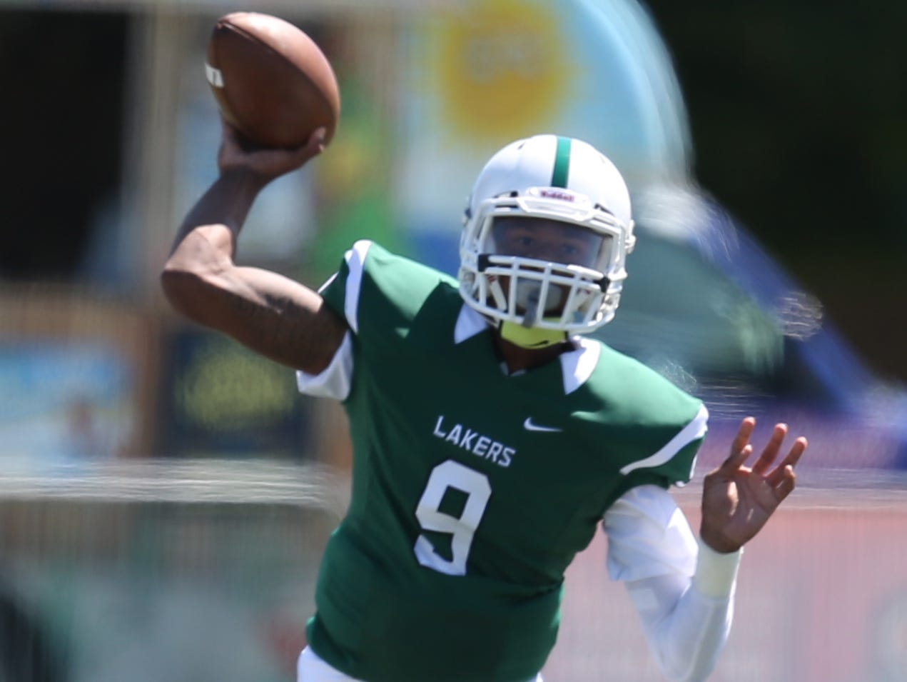 West Bloomfield high schools Trishton Jackson passes against Dearborn high school during first quarter action of the Prep Kickoff Classic on Thursday, August 28, 2014 at Tom Adams Field on the Wayne State campus in Detroit. Kirthmon F. Dozier/Detroit Free Press