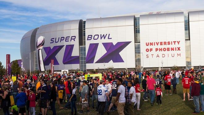Fans enjoy themselves outside University of Phoenix Stadium before the Pro Bowl in Glendale on Jan. 25, 2015.