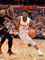 Junior guard Frank Howard (1) and sophomore Tyus Battle never come off the floor because the Syracuse roster is so thin, but at times they can carry the Orange.