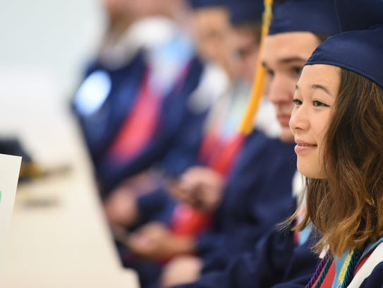 Hanna Kivlighan awaits the start of the 2018 Commencement