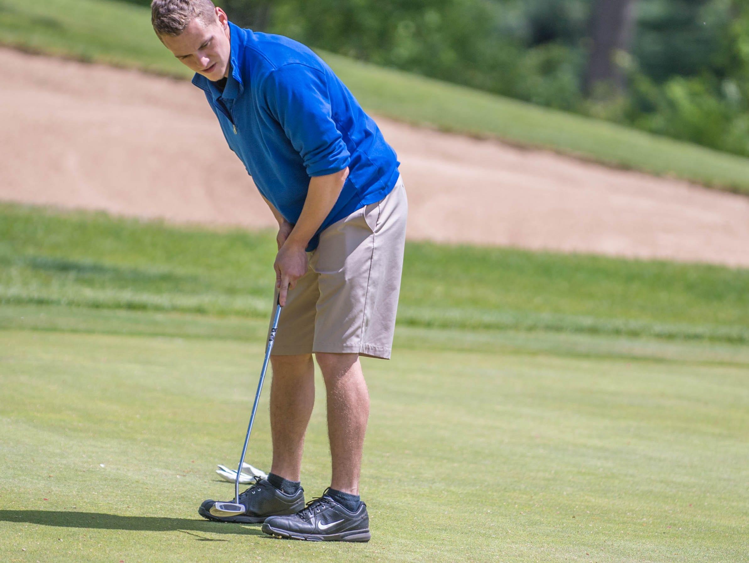 Harper Creek senior Zachary Wilson hits his putt during All City High School Golf at Riverside Golf Club on Friday.