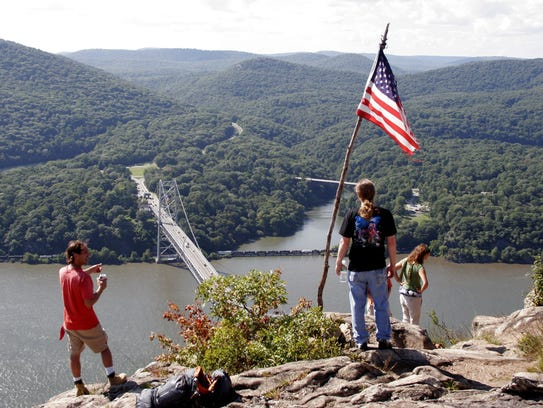 Hiker's enjoythe view of the Hudson River at the Bear