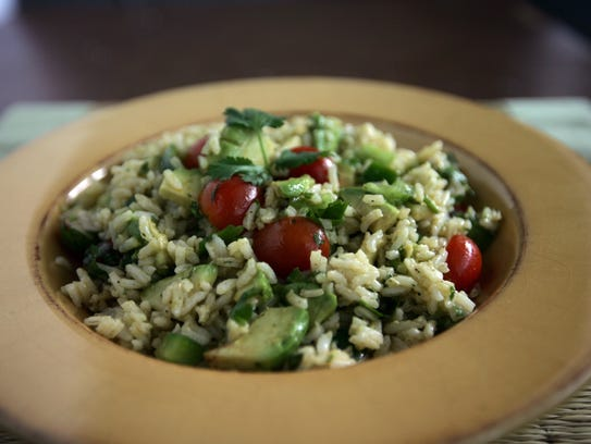 A bowl of Avocado grape tomato rice salad in the Free