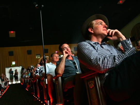 Actor Matthew Modine watch a program at the 2012 Palm