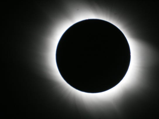 A total solar eclipse was captured by a fellow passenger