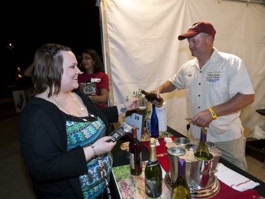 John McLoughlin pours a sample of Jerome Winery Pink