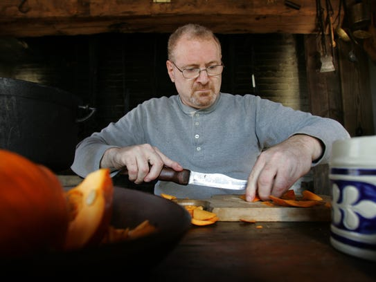 Beckerman prepares a pumpkin for stewing.