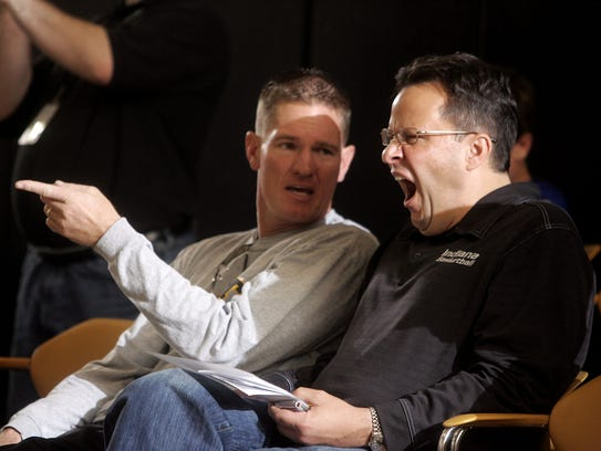 Indiana coach Tom Crean, right, enjoys the action while
