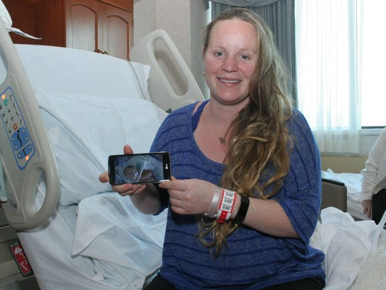 Naomi Longnecker holds a picture of her baby, who is
