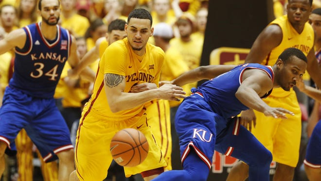 Iowa State forward Abdel Nader (2) chases down a ball he knocked loose from Kansas guard Wayne Selden Jr. (1) Monday during the Cyclones' 85-72 win at Hilton Coliseum in Ames.