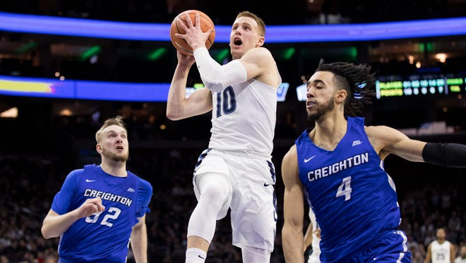 Villanova guard Donte DiVincenzo drives past Creighton forward Toby Hegner and guard Ronnie Harrell Jr. during the first half at Wells Fargo Center in Philadelphia.