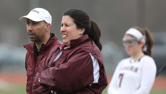 Scarsdale's Athletic Director Ray Pappalardi coaches girls lacrosse team with Megan Matthews during game action against Mahopac at Scarsdale High School on March 29, 2018. Mahopac defeats Scarsdale 10-8.