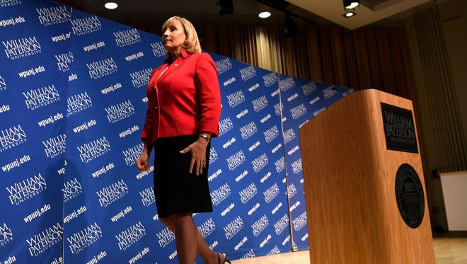 Lt. Gov. Kim Guadagno, the Republican candidate for governor, walks off the stage after answering questions from the media to end the final debate at William Paterson University last Wednesday, Oct. 18.