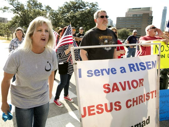 Protester Christine Weick yells at Muslims during the