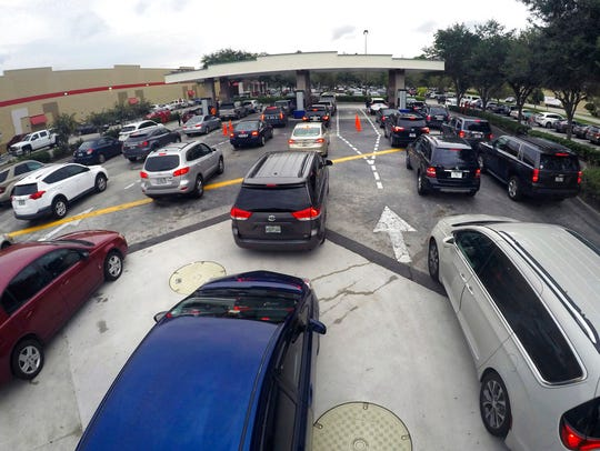 Drivers wait in line for gasoline   in Altamonte Springs,