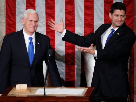 House Speaker Paul Ryan gestures toward Pence on on