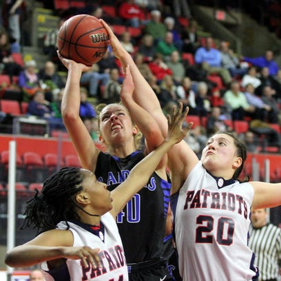 Katie Reasons of Horseheads shootsover the outstretched