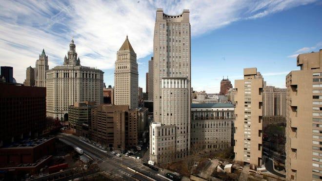 Manhattan Federal court, center and Metropolitan Correctional Center are seen in New York.