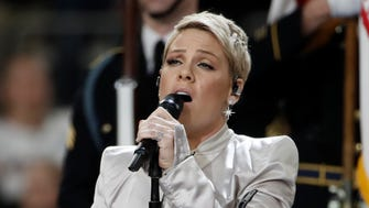 Singer Pink, performing at the Super Bowl on Feb. 4, tweeted she is postponing Friday's show in Montreal.