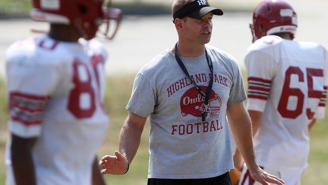 Highland Park coach Rich McGlynn works with his team during preseason football practice, Tuesday, August 18, 2015, in Highland Park, NJ.