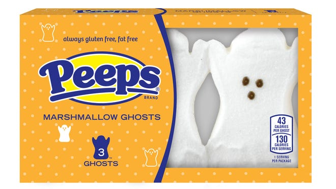 """This product image released by Peeps shows marshmallow treats in the shape of ghosts. The people who make those marshmallow treats once a long, long time ago the delight of Easter have been reinvented for just about every occasion, including Halloween. One box of five Halloween green chicks comes with a plush, five-inch """"witch chick"""" with a black hat. Pumpkin Peeps in orange can be had in a 24-count tray, and white ghost Peeps can be had three or nine at a time. (AP Photo/Peeps)"""