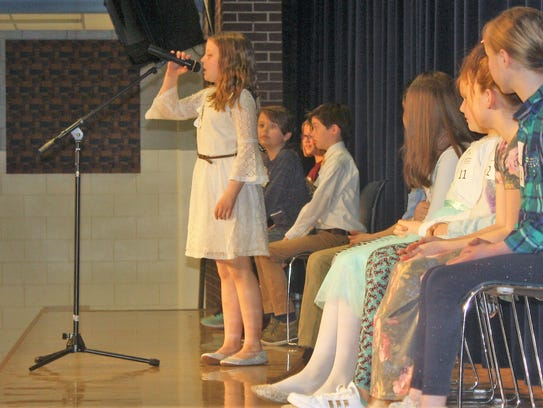 A fourth-grader speller focuses on her word during Monday's competition.