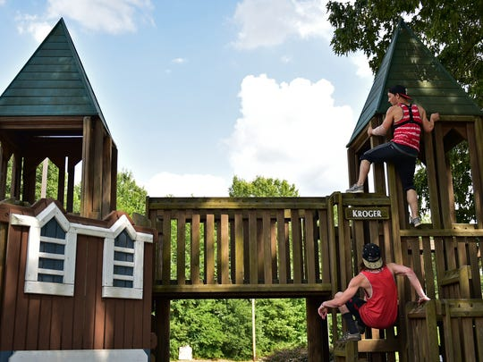 Dustin Cooke, top, and Tyler Clawson turn park facilities in Jackson into Parkour obstacles to overcome.