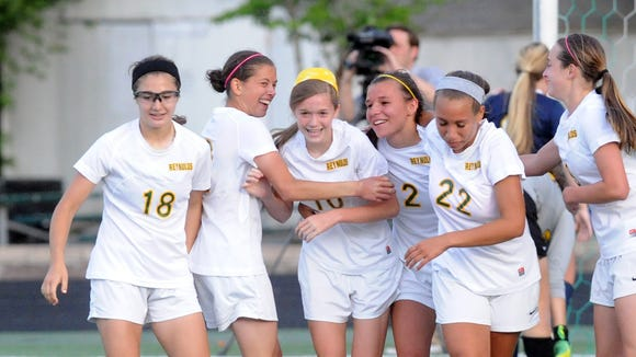 Reynolds players celebrate after a goal by Megan McCallister (10) on Saturday.