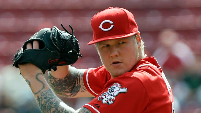 FILE - In this Sept. 25, 2013 file photo, Cincinnati Reds pitcher Mat Latos throws against the New York Mets in the first inning of a baseball game in Cincinnati.