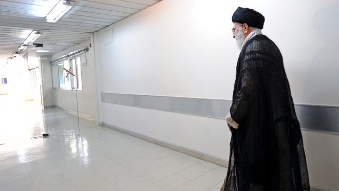 Ayatollah Ali Khamenei leaves a hospital Sept. 15, a week after he underwent prostate surgery in Tehran.