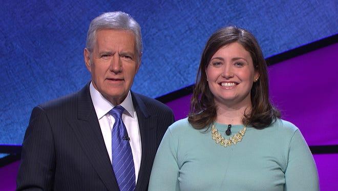 Alex Trebek, and contestant Julia Collins, 31.