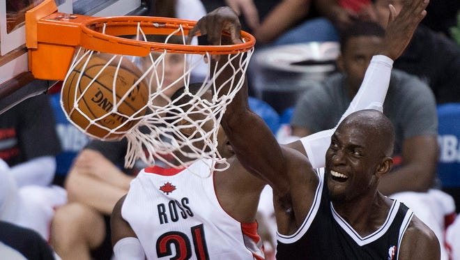 Brooklyn's Kevin Garnett, right, dunks against Toronto during the second half of Game 2 on Tuesday.