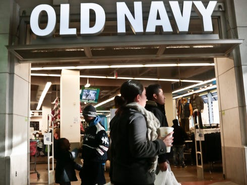 This Nov. 23, 2013 file photo shows shoppers approach Old Navy store at Atlantic Terminal Mall in New York.