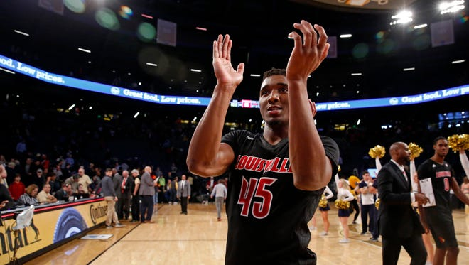 Jan 7, 2017; Atlanta, GA, USA; Louisville Cardinals guard Donovan Mitchell (45) celebrates their win against the Georgia Tech Yellow Jackets at McCamish Pavilion. The Cardinals won 65-50. Mandatory Credit: Jason Getz-USA TODAY Sports
