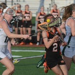 Brighton's Bella VanBuren (2) scored Monday night, but the Bulldogs lost to Marian, 17-7, at home.