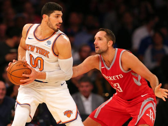 New York Knicks center Enes Kanter (00) controls the ball against Houston Rockets power forward Ryan Anderson (33) during the second quarter at Madison Square Garden.