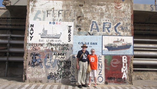Nancy and Douglas Cameron of Spruce took the D to the graffitied pier of Mindelo, Cape Verde.  The were on a cruise from Cape Town to London in May.