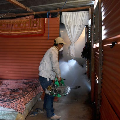Health Ministry employees fumigate against the Aedes aegypti mosquito, carrier of the Zika virus,  n Guatemala City on Feb. 5, 2016. The World Health Organization says the virus has spread to almost 30 countries.