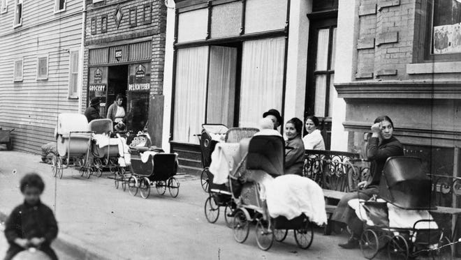 In this Oct. 27, 1916 photo made available by the Library of Congress,  People with baby carriages sit in front of the Sanger Clinic in the Brownsville area of the Brooklyn borough of New York. Margaret Sanger, her sister, Ethyl Byrne, and colleague, Fania Mindell, opened the America's first birth control clinic on Oct. 16, 1916. The three sought to provide birth control advice to low-income immigrant women.