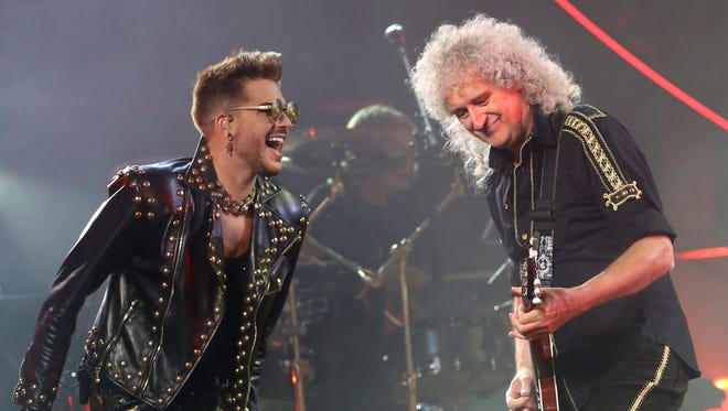 Adam Lambert, left, and Brian May of Queen + Adam Lambert perform at Madison Square Garden on Thursday, July 17, 2014 in New York. (Photo by Greg Allen/Invision/AP)