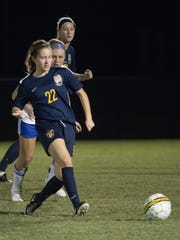 Dribbling the ball during Tuesday's NJCAA contest in Melbourne, Fla. is Schoolcraft's Jenna Smith (No. 22) of Milford.