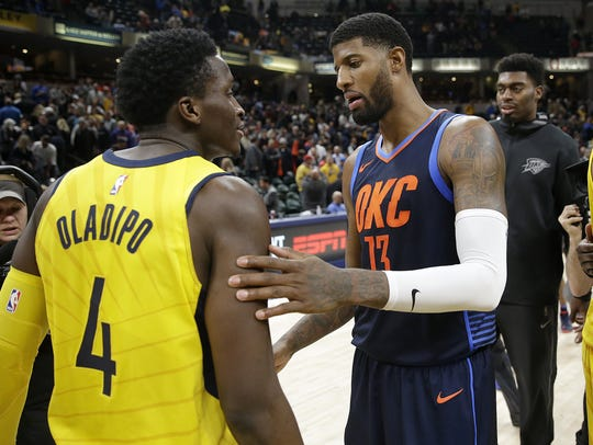 Paul George, right, and Victor Oladipo, traded for