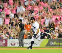 Collins homered twice, including a game-changing, ...