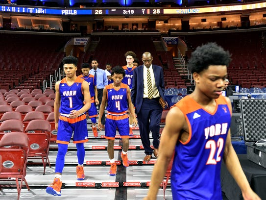 The William Penn boys' basketball team leaves the stands