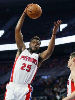Detroit Pistons' Reggie Bullock (25) grabs a rebound against the Carolina Hurricanes during the second half of a preseason NBA basketball game Wednesday, Oct. 21, 2015, in Auburn Hills.