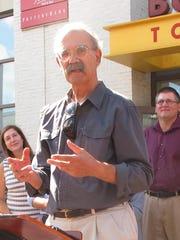 Jan Schultz, center, an advocate for adding a district