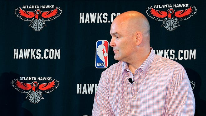 FILE - In this May 29, 2013, file photo, Atlanta Hawks general managerr Danny Ferry waits during a news conference in Atlanta.  A double dose of racially inflammatory comments by the Atlanta Hawks' leadership has created a a crisis that threatens to resonate on the court and in the stands. This is a team that already ranked 28th out of 30 teams in attendance last season.