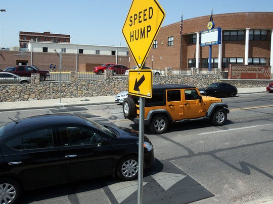 """Drivers slow down as they make their way over speed bumps placed along N. Stanton in front of Cathedral High School Monday near downtown El Paso. """