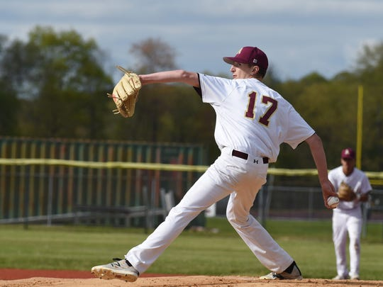 Arlington's Matt McGowan winds up a pitch during Wednesday's game against Mahopac.